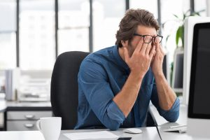 Man stressed out at his desk